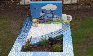 Kindergraf in mozaiëk